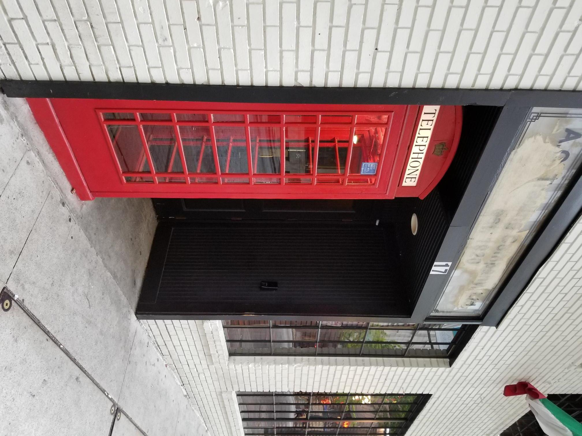 Old World Nostalgia Meets New World Chic at Red Phone Booth